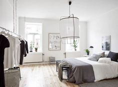 An oversized chandelier steals the spotlight and completes the look in this delightfully simple, modern bedroom.