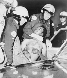 Watts Riots   August 11 to 17, 1965.Police arrest a man during the Watts riots. My family and I left for a planned trip to Houston,Texas the night the Watts Riots began. When we returned home we found that the riot had progressed within blocks of our home.