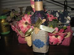 Hand painted square vintage bottle with blue laquer paint, decorated with ribbons, blue daises, a petite mouse and jute ribbon