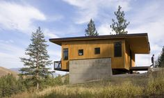 Prentiss Balance Wickline Architects designed the Pine Forest Cabin, a modern retreat in Washington with small site impact.
