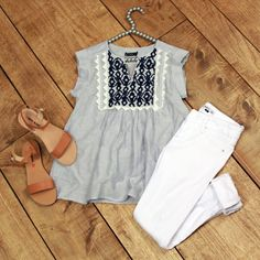 Bella Blue Top is true southern charm. This babydoll style top has blue and white pinstripes and navy embroidered bib with white lace.