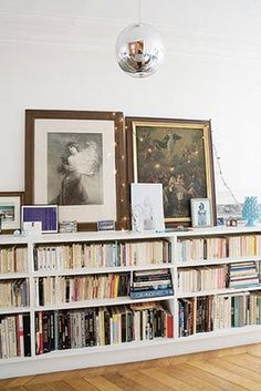 bookcase: bookcase with lots of books + topped with art & fun finds (via…