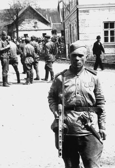 Soviet soldiers are photographed on the streets of the Czech village of Cotkytle following the Soviet liberation of the region from the Germans. The soldier in the foreground carries with him an Waffen-SS dagger affixed to his belt, taken as a...pin by Paolo Marzioli