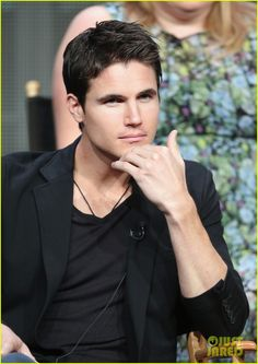 Robbie Amell listens intently while answering questions during The Tomorrow People panel at the 2013 Summer Television Critics Association Tour