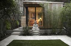 The focal point of the upper garden is a large garden office in the bottom right hand corner. #gardenoffice #roominagarden #artificallawn #buddha