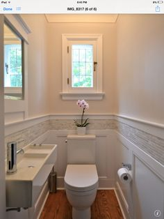 Half bathroom. Sink with exposed plumbing