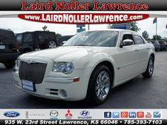 Used 2006 Chrysler 300C Base For Sale in Lawrence Kansas -  Top features include heated front seats, a leather steering wheel, adjustable pedals, and power front seats. Under the hood you'll find an 8 cylinder engine with more than 330 horsepower, and for added security, dynamic Stability Control supplements the drivetrain.   You will have a pleasant shopping experience that is fun, informative, and never high pressured. Stop by our dealership or give us a call for more information…