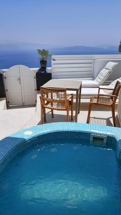 Wouldn't you love to relax in a hot tub with a view like this? At Santorini Secret Suites and Spa you can!