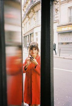 red coat, chignon, bangs