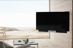 """#BeoVisionAvant 55"""" mounts elegantly on the wall and, despite its size, pivots serenely up to 60 degrees from its starting position.  Discover more at www.bang-olufsen.com/picture/beovision-avant/design"""