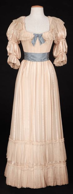 """(Paramount, Ivory and satin chiffon striped period dress accented with blue satin bow and sash. Designed by Raoul Pene Du Bois. Worn by Paulette Goddard as """"Kitty"""" when Ray Milland is teaching her how to be a lady in Kitty. Old Fashion Dresses, Old Dresses, Vintage Gowns, Vintage Outfits, Victorian Dresses, Edwardian Fashion, Vintage Fashion, Vintage Beauty, Pioneer Dress"""