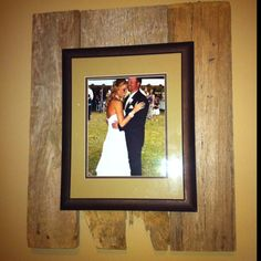 Picture hung on old barn wood