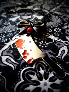 Deadly Dame Cleaver necklace by LttleShopOfHorrors on Etsy, $13.00