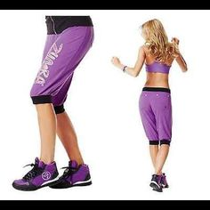 SHAKE YOUR SHUTTLE CAPRIS-ZUMBA Fitness (Orchid) When it's time for liftoff, make sure you have a good co-pilot! The Capris bring knee length cotton and oh-so-cozy comfort to the pants party. You'll be able to drop it, pop it & do anything but stop it when you're breakin' it down in the next-level, relaxed fit pants. Colour blocked leg cuffs and waistband Fabric bunches at knee for a baggy look! Back pockets have signature logo engraved rivets! Body: 62 polyester / 33 cotton / 5 spandex…