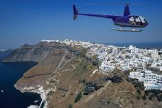 Helicopters tours over the Caldera can be arranged for you by Oia Mansion's concierge. Oia Village, Santorini island, Greece.  -www.oiamansion.com