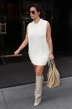 White dress with boots on Kim Kardashian.