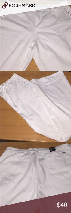New white high waist flare jeans New York & co white jeans. Trendy buttons on side pockets. 30 inch inseam. Soho jeans. New York & Company Jeans