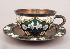 Lot: Soviet Russia gilt silver and enamel teacup and saucer, Lot Number: 0111, Starting Bid: $100, Auctioneer: Stephenson