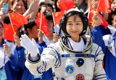 Lu Yang, China's first female astronaut, waves during a departure ceremony at Jiuquan Satellite Launch Center, Gansu province, on June 16, 2012. China sent its first woman taikonaut into outer space, prompting a surge of national pride as the rising power takes its latest step towards putting a space station in orbit within the decade.
