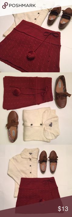 Necessary Objects Burgundy Wool Skirt Festive burgundy knit patterned skirt for a cozy Fall look by Necessary Objects. The adjustable drawstring creates a relaxed fit with an adorable pom-pom on one end. Fifteen inches in length made of 50% wool and 50% acrylic. Necessary Objects Skirts