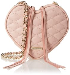 A heart-shaped Rebecca Minkoff bag styled in soft, quilted leather. Long tassels hang from the top two-way zips. Lined interior with inset mirror. Interwoven chain shoulder strap. Dust bag included...
