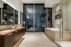 In the heart of downtown, this spacious penthouse's floor plan is ideal for entertaining guests.