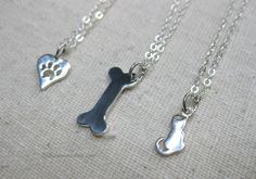 Pet kitten Paw print Dog Bone sterling silver pendant necklace Pet lovers jewelry Animal charms Modern simple minimalist petite jewelry - pinned by pin4etsy.com