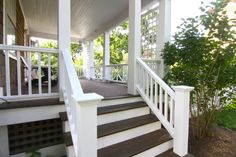 proper porch stairs and nice railings (these are in cedar for longer wear) - like the white with the dark stained wood treads