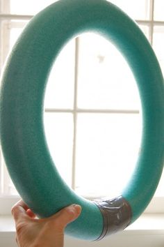 "Take a swim noodle from the dollar store and duct tape it together! 17"" wreath. Clever!!"
