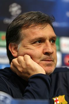 Barcelona manager Gerardo Martino listens to questions from the media at a press conference prior to a training session ahead of their UEFA Champions League Round of 16 match 1st leg against Manchester City at Etihad Stadium on February 17, 2014 in Manchester, England.