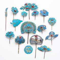 CHINESE 16 Kingfisher feather hair ornaments, some silver, some with coral or gemstones.