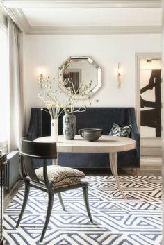 klismos chair, gray velvet settee, blue and white geometric rug, black and white art