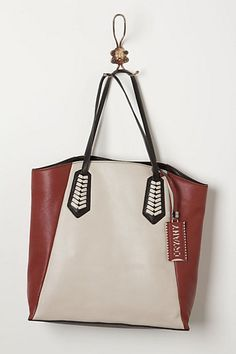 Color block tote with nice lacing detail. I dig the concept, if not the color combo.