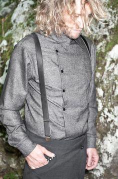 chef shirt, suspenders (braces), long hair, nonchalant pose.