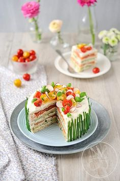 Pretty Sandwich Cake. You can use chicken/salmon/crab meat/lobster meat alongside vegetables. The recipe is in French. :)