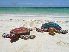 Turtles made from recycled marine debris. Andrew McNaughton, artist, Watamu Marine Association, Kenya.