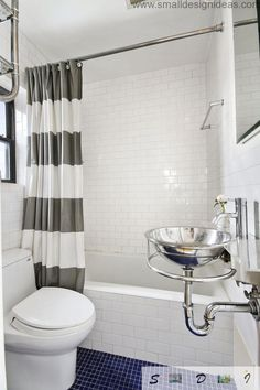 small bathroom with white subway tile, blue tile floor, white and gray striped shower curtain, freestanding metal sink. 5 Steps to Make Your Small Shower Look Bigger Without Remodeling from Bathroom Bliss by Rotator Rod Master Bathroom Shower, Modern Bathroom Tile, Bathroom Design Small, Bathroom Interior, Small Bathrooms, Bathroom Remodeling, Remodeling Ideas, Bathroom Ideas, Bathroom Remodel Pictures
