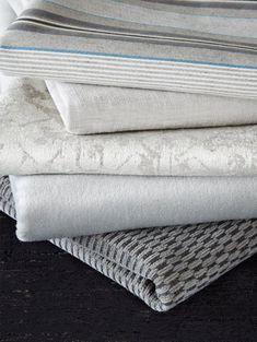 James Huniford Lee Jofa Gray Fabric Stack - #Fabrics Top To Bottom: Ketcham In Ash/Black 2014137-816, Judd In Silver 2014132-11, Atlantic In Oyster 2014136-11, Bennett In Greige 2014138-11, Hamilton In Stonewash 2014126-811, Noor In Black 2014125-8.