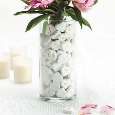 What a cute idea. You could even put a candle on top instead of a flower