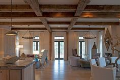 Pair the wood ceiling beams with rustic or antique chandeliers by Jack Gardner Wooden Beams Ceiling, Wood Ceilings, Coffered Ceilings, Plank Ceiling, High Ceilings, Porch Beams, Faux Wood Beams, Eclectic Living Room, Living Rooms