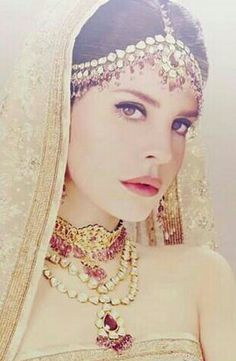 OMG, not once have I seen this photo! She looks amazing. She can pull off anything, as well as this Indian look!