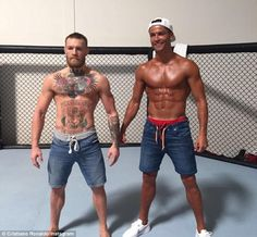 Macho men: Cristiano Ronaldo was so sure of his muscles that he jokingly challenged cage fighter and mixed martial artist Conor McGregor to a brawl on Tuesday