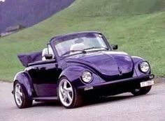 Purple convertible VW Bug [w/ Porsche wheels even, whaaa...!]