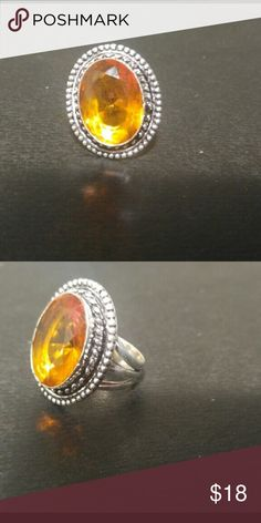 Sterling silver citrine or amber stone FRIM Sterling silver citrine or amber stone color believe it's a 7 because it's too tight on my finger very cute design FIRM no offers accepted thanks Jewelry Rings