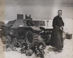 Navy Chaplain O. David Herrmann, of Omaha, Neb., attached to a Marine unit on Saipan, uses a destroyed Japanese tank (Type 95 Ha-Go light tank) for an altar as he holds services for the dead on June 24, 1944.