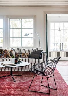 Love that striped couch with the midcentury modern bertoia chair. Feels Swedish and cozy and very hygge.