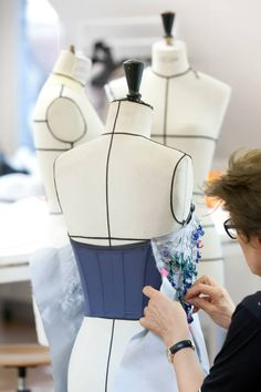 Dior. working on the stand with beaded bodice over corset