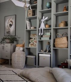 """@oskoeliving shared a photo on Instagram: """"Beautiful shelves filled with many of our favourites - special wooden toys and our Joseph night light. Tap for details. Thank you…"""" • Dec 28, 2020 at 7:12pm UTC Nursery Neutral, Neutral Nurseries, Playroom Decor, Wooden Toys, Night Light, Bookcase, Shelves, Simple, Beautiful"""