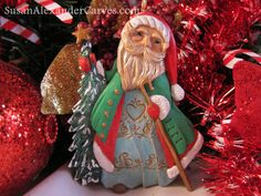 Tim, the Fashionista Handcarved Santa Ornament Christmas Wood Carving Holiday Gift Carvings for Sale Home Decor Wooden Art  Tim, the Fashionista Santa, is stepping out wearing his best Santa outfit that is decorated with gold filigree and gold buttons. Hes not wearing his red suit. Hell save that one for when he goes down the chimney!  Dimensions of this relief-carving ornament: 4.50 tall x 3.25 at its widest, and about .25 deep. Thank you for taking the time to stop at my Etsy shop and look…