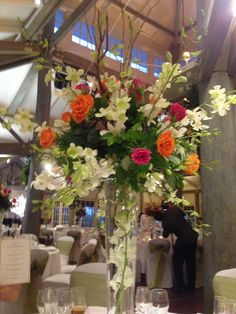 Red and orange roses and freesia table centre pieces at Sanctuary Cove The Grange room WOW  Suzanne Riley Marriage Celebrant  Sunshine Coast   www.suzanneriley.com.au